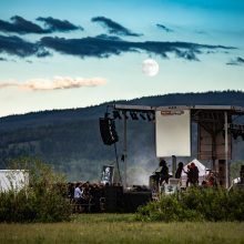 Ruins of Beverast live at Fire in the Mountains 2019, full moon in the background over the mountains, picture taken from behind the stage